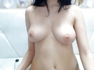 Black-haired hottie is masturbating on webcam