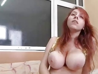 Big ass redhead orgasms while playing with her tasty snatch
