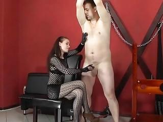 German mistress giving him a handjob