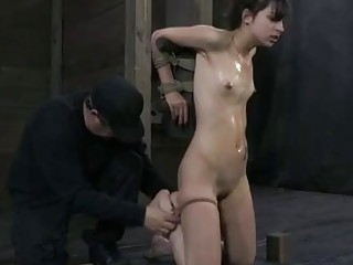 Teen blonde is tied up and cock gagged