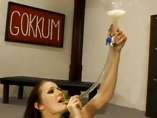 Pornstar swallows cum in a bukkake clip