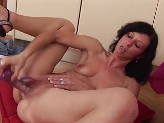 Mature woman double penetrates her holes with sex toys solo