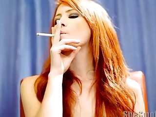 Redhead beauty smoking a cigar and being naughty