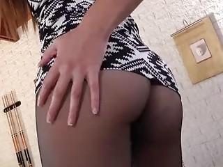 Adorable brunette darling is teasing her shaved twat
