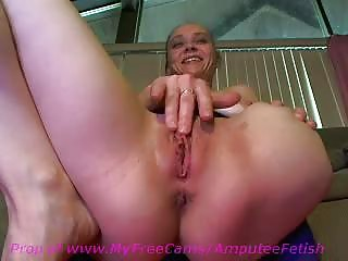 Horny amateur girl with a stump masturbates