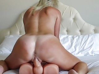 Blonde cougar MILF masturbates and toys her self in bed