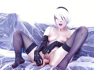 Oily cosplay woman in stockings likes to toy her ass