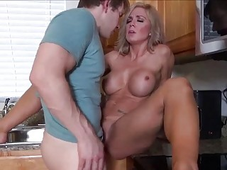 Nice blonde milf shows this young dude some hardcore screwing