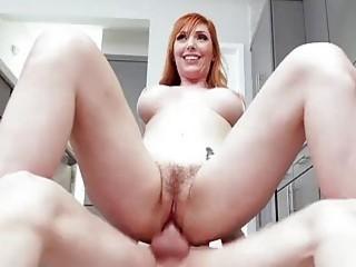 Seductive redhead licks that dick and enjoys getting it hard