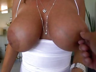 Hot MILF with extra big tits swallows a fat prick