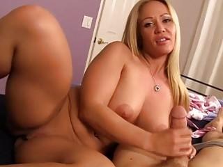 Blonde MILF pleasures a hard pecker