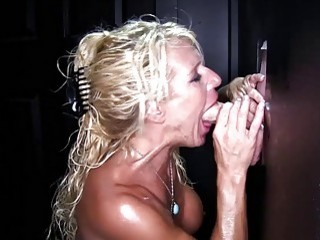 MILF gets down on her knees for a glory hole