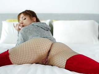 Beautiful babe in fishnets plays with her pussy