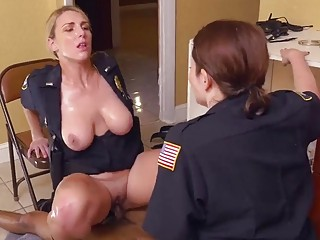 Officers handle a big black cock while busting him