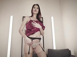 Striking brunette strips her erotic lingerie before masturbating with toys