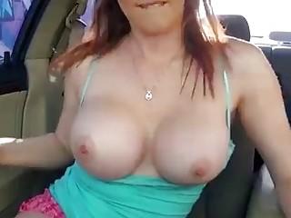 Rainia Belle shows her big tits and fucks hard outside
